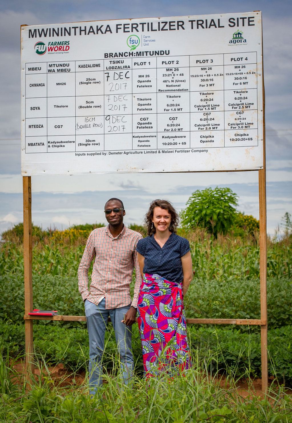 Caitlin with Martin Tsere, FSU's data analyst, at one of the demonstration plots